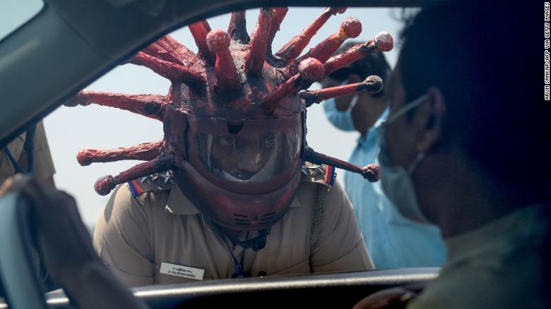 Stay At Home: Policeman Wore Corona Virus Helmet To Warn People